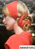 Vlasy zamotané do uzlu svázané stuhou